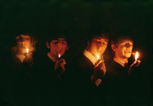 The Beatles lighting up a smoke
